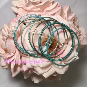 Jewelry - Set of 9 turquoise and gold colored bracelets